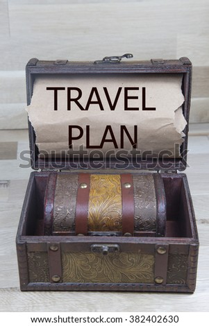 travel plan is written on the Brown torn paper in the wooden treasure box
