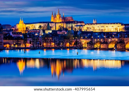 Travel Prague Europe concept background - view of Charles Bridge and Prague Castle in twilight. Prague, Czech Republic - stock photo