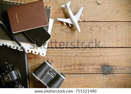 Travel preparations on wooden plank, travel concept background