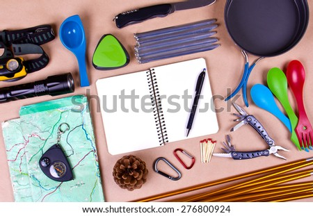 Travel set. Tourist outfit for camping or hiking. Various professional tools and items for outdoors pastime on beige background. Place for your text. - stock photo