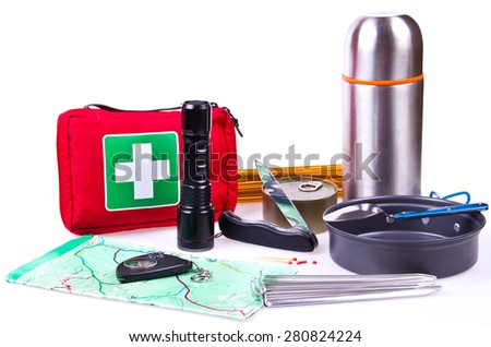 Travel set. Tourist outfit for camping or hiking. Various professional tools and items for outdoors pastime on white background, partly isolated with shadows. Place for your text. - stock photo
