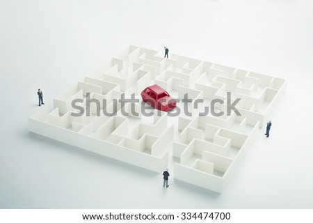 Travel solution. Businessmen navigating through the maze in search of a car - stock photo