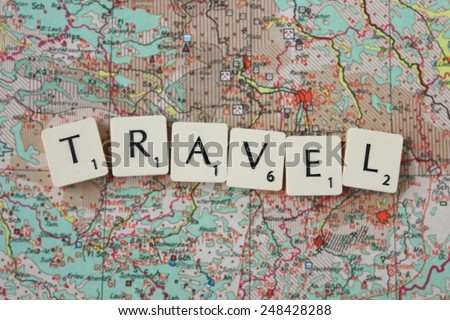 Travel spelled on map - stock photo