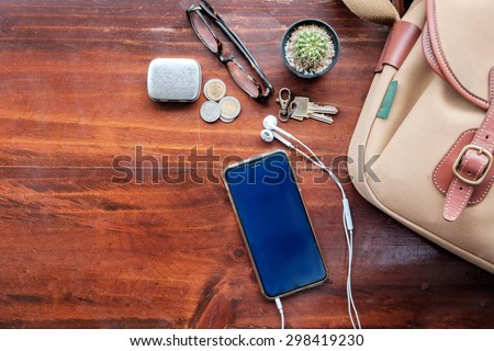 Travel stuff on wood desk top. tourism and objects concept, summer vacation, - stock photo