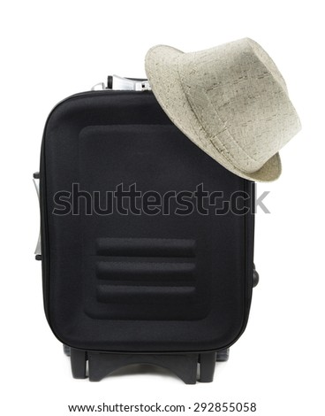travel suitcase and hat over white