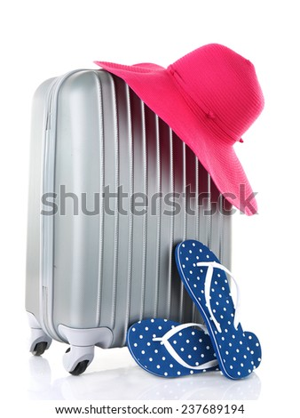 Travel suitcase, hat and flops isolated on white