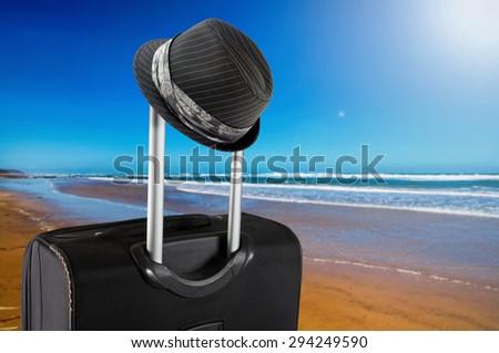 travel suitcase on the beach - stock photo