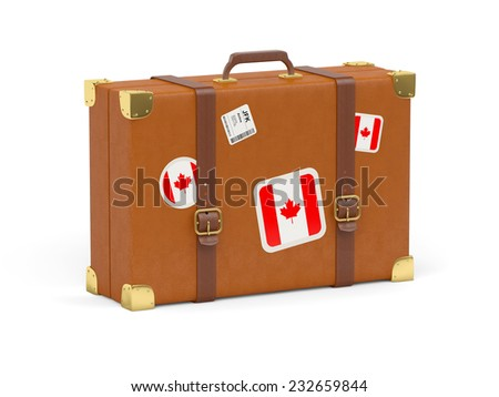 Travel suitcase with flag of canada isolated on white - stock photo
