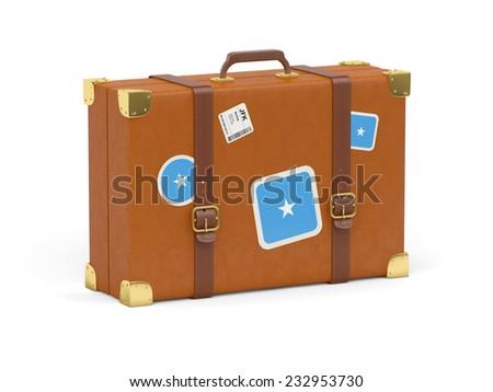 Travel suitcase with flag of somalia isolated on white - stock photo