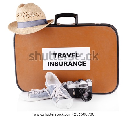Travel suitcase with inscription  travel insurance isolated on white - stock photo