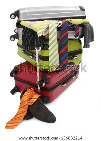 travel suitcase with personal belongings isolated on white  - stock photo