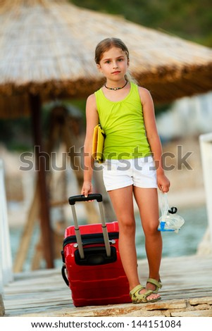 Travel, summer  - young girl on the road to summer resort - stock photo