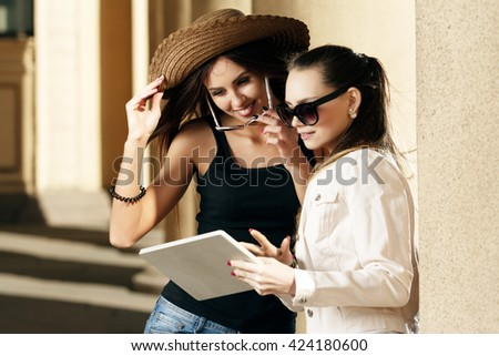 Travel, the girls are photographed tablet. - stock photo