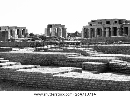 Travel to ancient Egypt - vintage photo in retro style. Ancient ruins of Anubis temple in Luxor. Old architecture and mythology of the great Egyptian civilization. - stock photo