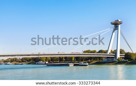 travel to Bratislava city - view of Most SNP (Bridge of the Slovak National Uprising, UFO Bridge, Novy most, New Bridge) road bridge over Danube river in Bratislava - stock photo