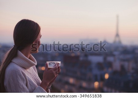 travel to Paris, woman looking at Eiffel tower and beautiful panorama of the city - stock photo
