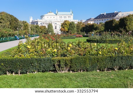 travel to Vienna city - Volksgarten (People's Garden) public park and view of Burgtheater building, Hofburg, Vienna, Austria. - stock photo