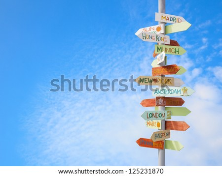 travel traffic sign and blue sky - stock photo