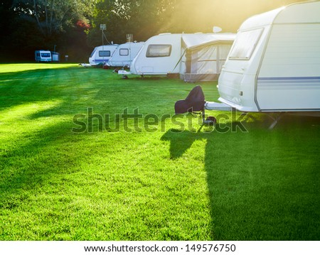 Travel trailer camping in a morning light - stock photo