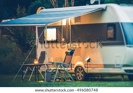 Travel Trailer Caravaning. RV Park Camping at Night.