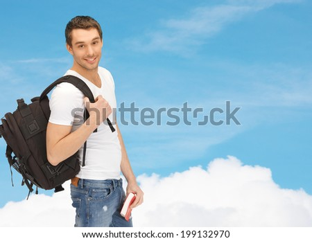 travel, vacation and education concept - travelling student with backpack and book - stock photo