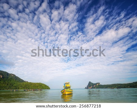 Travel vacation background - beautiful beach with colorful sky and boat, Thailand - stock photo