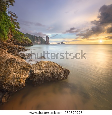 Travel vacation background - beautiful beach with colorful sky, Thailand - stock photo