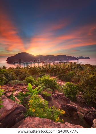Travel vacation background - Tropical island at sunset with resorts - Phi-Phi island, Krabi Province, Thailand - stock photo