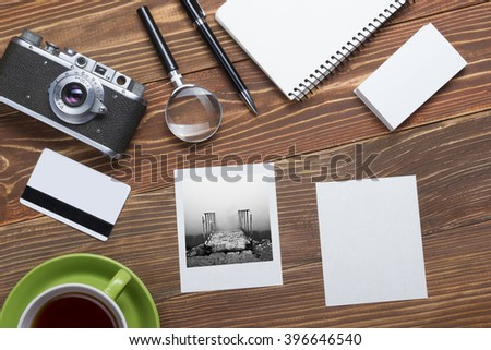 Travel, vacation concept. Camera, notepad, pen, credit card, supplies and photography on office wooden desk table. Top view with copy space for text - stock photo