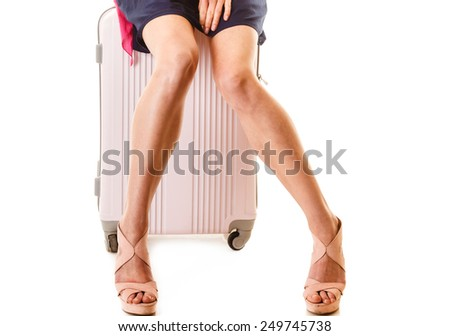 Travel vacation concept. summer fashion woman in voyage, female legs and pink suitcase luggage bag. - stock photo