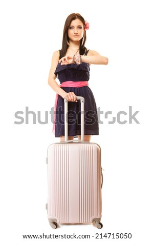 Travel vacation concept. Summer fashion woman in voyage, girl in full length with pink suitcase luggage bag looking at hand watch. - stock photo