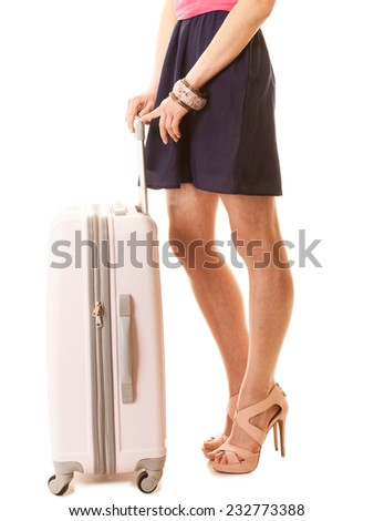 Travel vacation concept. Young summer fashion woman in voyage, female legs in high heels with pink suitcase luggage bag. - stock photo