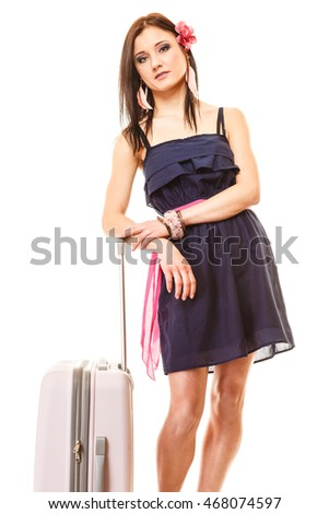 Travel vacation concept. Young summer fashion woman in voyage, girl in with pink suitcase luggage bag.