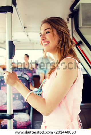 travel, vacation, summer, transport and people concept - smiling teenage girl going by bus