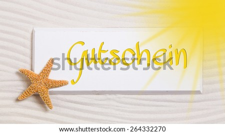 Travel voucher with the german word for a gift certificate,  - stock photo