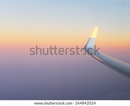 Travel.Wing in the sky - stock photo