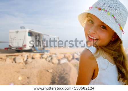 Travel with camper, summer beach - beauty girl on summer vacation - stock photo