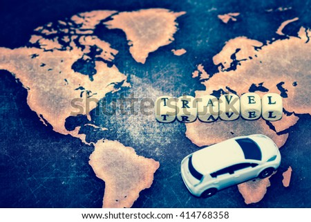 TRAVEL with toy car on grunge world map - stock photo
