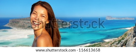 Travel woman banner. Summer vacation woman laughing smiling joyful on beach background from lagoon Gramvousa, Crete, Greece. - stock photo