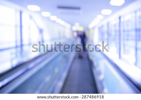 Travelator in airport out of focus - abstractl background. Toned in blue - stock photo