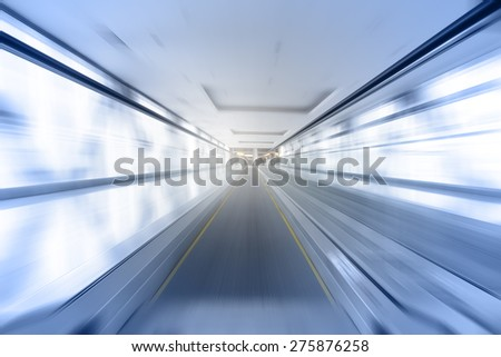 Travelator in motion - abstract business and architectural background - stock photo
