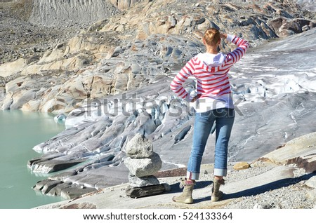 Traveler against Rhone glacier. Switzerland