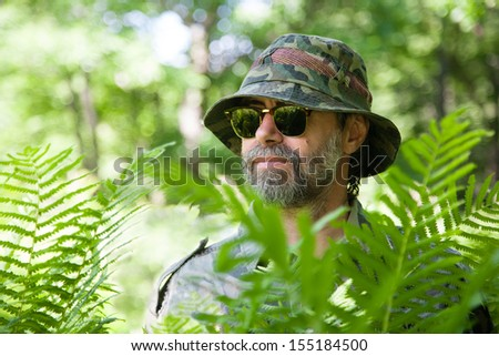 Traveler among the thickets of the rainforest. - stock photo