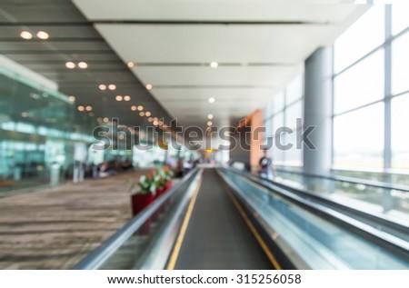 Traveler at airport terminal blur background with bokeh light,Vintage filter - stock photo