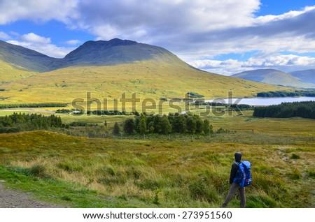 Traveler at Highlands in spring, Scotland, UK - stock photo