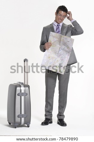 Traveler businessman holding a map. - stock photo