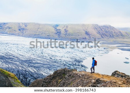 traveler enjoying panoramic view of glacier in Iceland