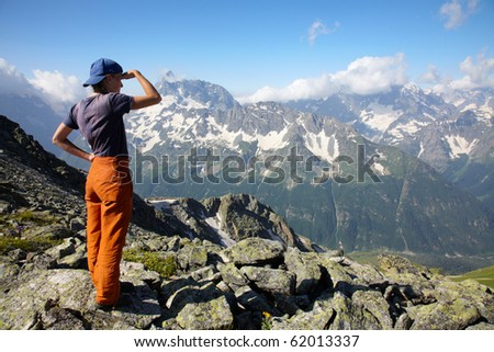 Traveler girl looking to far mountains