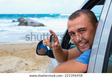 traveler in the car on the background of the sea - stock photo
