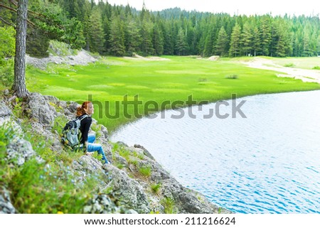 Traveler infront of lake view and mountains - stock photo